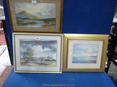 A framed and mounted Watercolour of a River landscape with open valley and hills in the distance,
