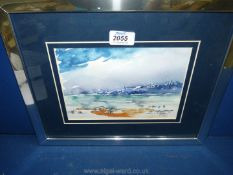 A framed and mounted watercolour of a landscape with buildings on a hillside,
