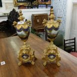 A pair of gilt metal and porcelain Sevres style garnitures