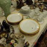 A set of ten Pinken Hammer Czech porcelain gold and white dinner plates