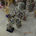 A quantity of assorted figures including Lladro
