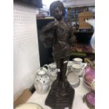A bronze girl with basket