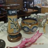 A Doulton Lambeth Jardiniere and stand (slight damage to slip ware applied decoration)