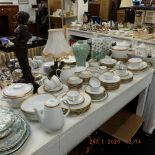 A Rosenthal porcelain dinner set with gilt rim