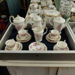 A floral decorated porcelain part coffee set