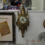 A French gilt brass wall clock circa 1900