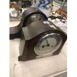 A Napoleon hat clock and a oak clock
