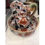 A porcelain jug and bowl set