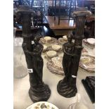 A pair of art deco style figural candle sticks