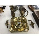 A large brass ashtray,