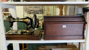 A mahogany cased Singer sewing machine
