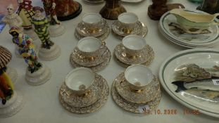 A six place Imperial bone china, white and gilt tea set, two cups a.
