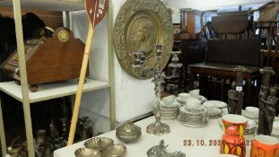 A large plated candlebra, dishes,