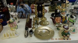A collection of brass ware, candles and figures etc.