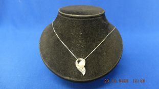 A 9ct white gold diamond pearl set pendant on chain