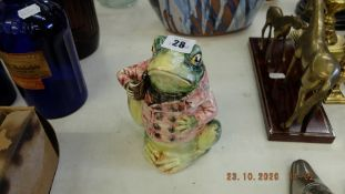 A colourful frog figure with lid,