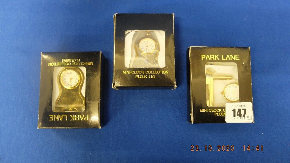 Three mini clocks,