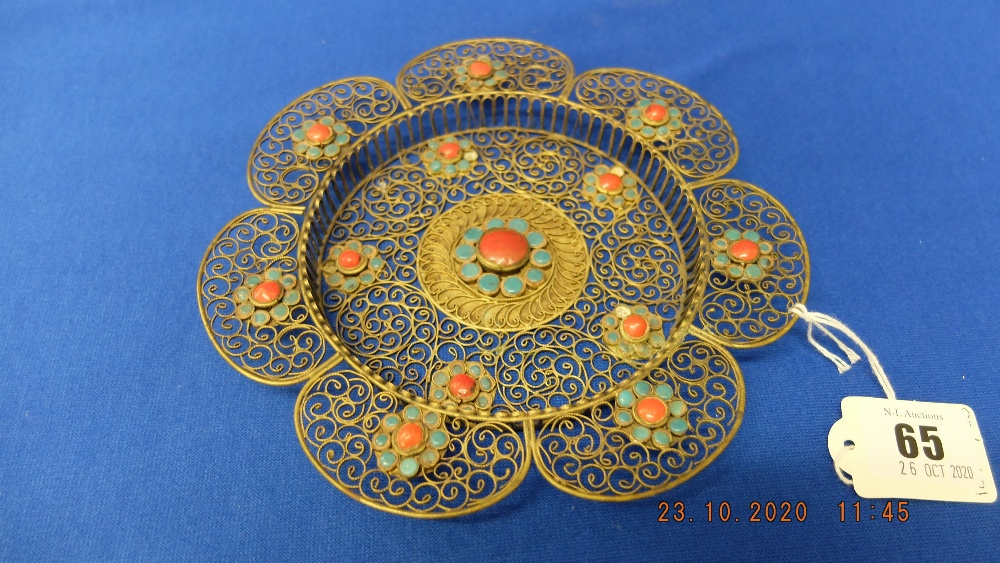 A brass patterned dish with turquoise stones etc.