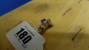 A 14ct gold sapphire and diamond ring