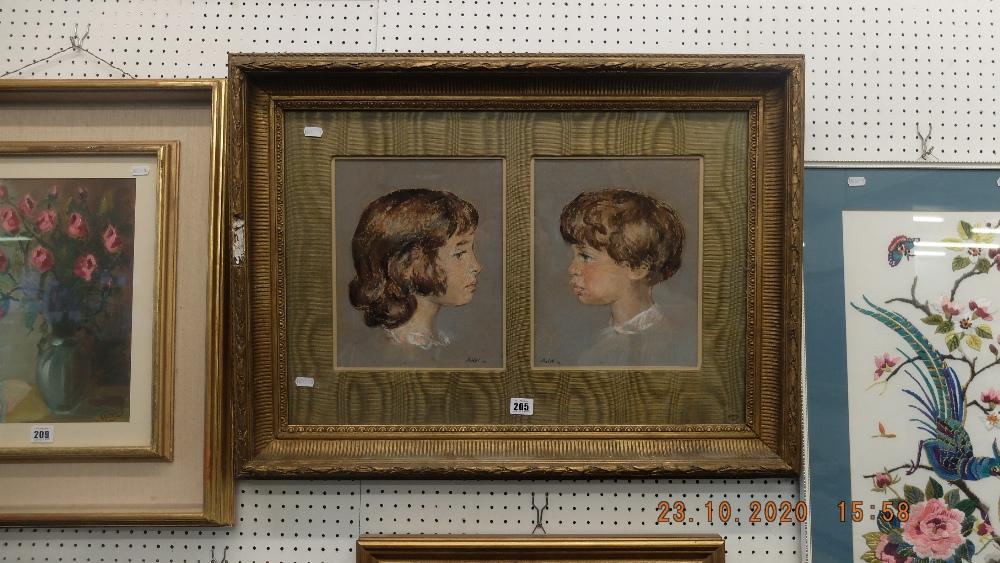 A gilt framed pastel of children