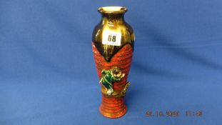 An oriental vase, signed a.