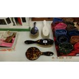 A tortoiseshell and hm silver dressing table set