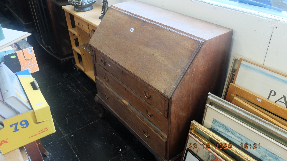 An oak bureau with three drawers