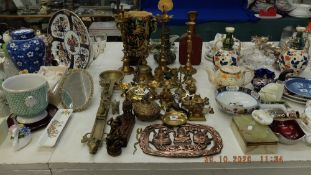 A collection of brass religious items