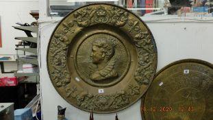 A brass wall plaque