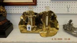 Gold coloured metal design twin candle holder, signed G.