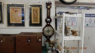 A mahogany/ ebony barometer,