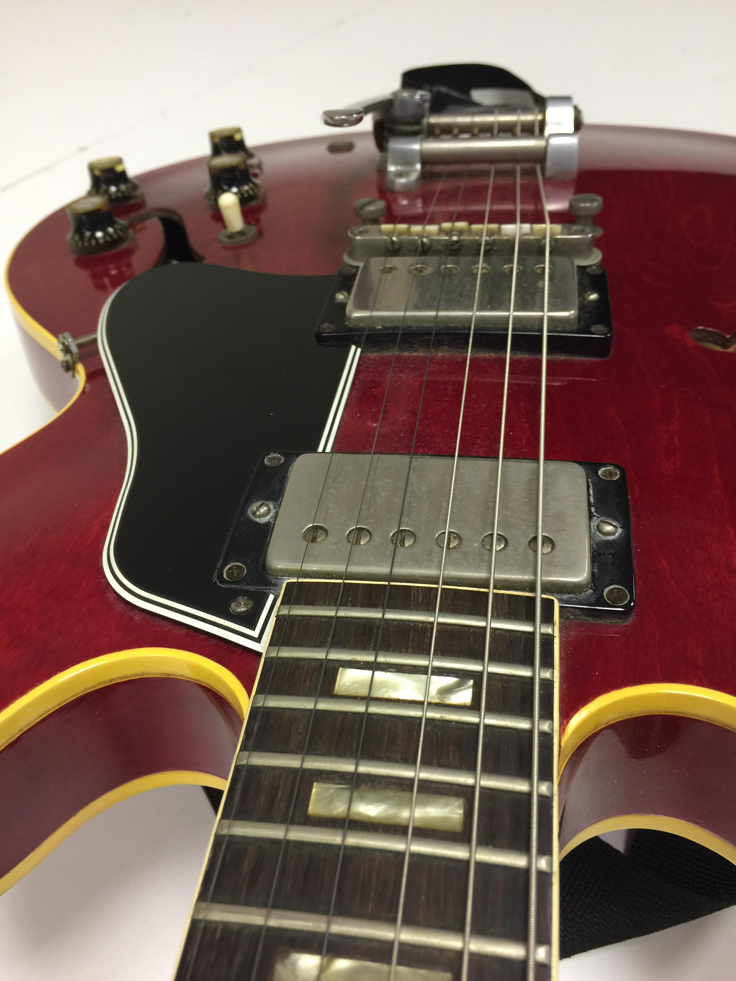 Lot 25 - 1963 GIBSON 335 CHERRY RED ELECTRIC GUITAR.