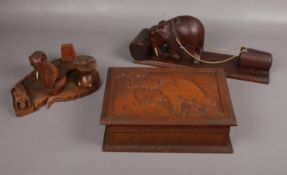 A carved wooden jewellery box, to include two wooden decorative wares