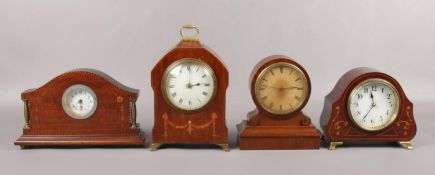 Four Edwardian mahogany and walnut cased mantel clocks, some inlaid and with French movements.
