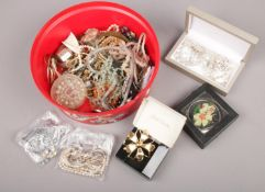 A box of costume jewellery, to include brooches, simulated pearls, pendants etc.