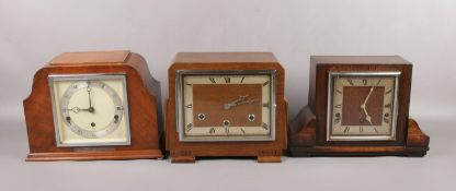 Three 8 day mantel clock with Westminster chime. Two oak cased including Garrard and a walnut