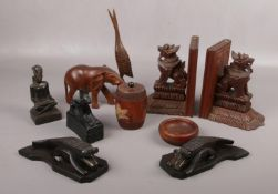 A collection of mainly wooden decorative wares, book ends, Elephant, dish examples