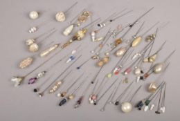 A collection of hat pins, to include sugar paste examples