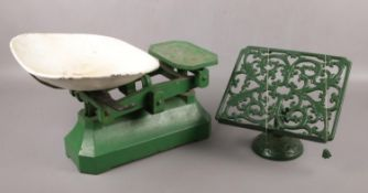 A set of kitchen scales, along with an iron recipe stand.