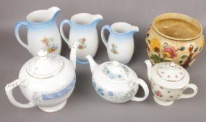 A group of ceramics to include Wedgwood, Royal Doulton, three Newhall graduated jugs, Coalport etc