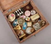 A wooden box of various pill boxes.