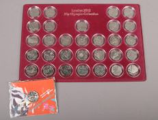 A London 2012 Olympic 50 pence collection, a full set of 29 coins to include 2012 Royal Shield of