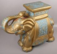 A decorative gilt pottery stand formed as an Indian elephant.