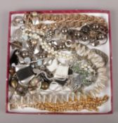 A tray of costume jewellery, to include gilt metal chains, necklaces etc.