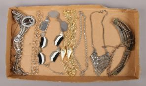A tray of decorative costume jewellery necklaces.