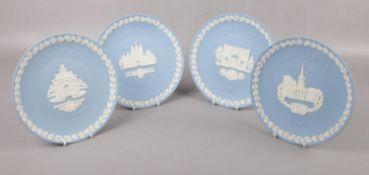 Four Wedgwood blue Jasperware plates, Christmas 1980, 1981, 1983, 1984.