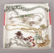 A tray of costume jewellery, to include pendants on chains, necklaces etc.