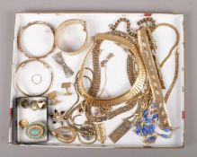 A collection of gilt metal costume jewellery, to include brooches, bracelets, cufflinks etc.