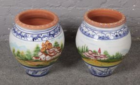A pair of large painted terracotta vases. (Height 46cm).