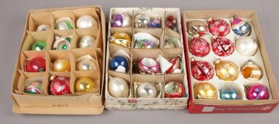 Three boxes of vintage glass baubles to include different colours and sizes.